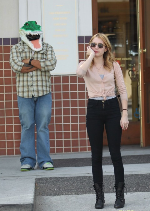 Emma Roberts photobombed by Croc Man