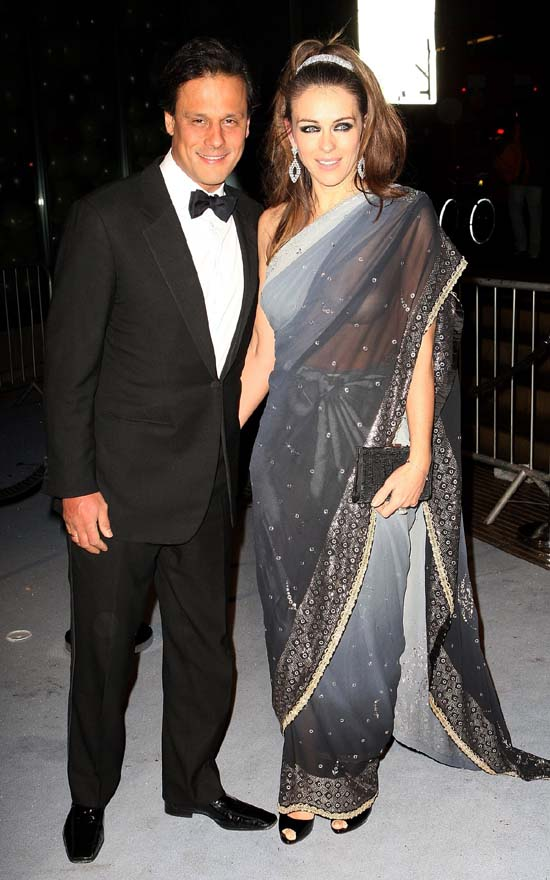 Elizabeth Hurley in a sari and it looks like she forgot something