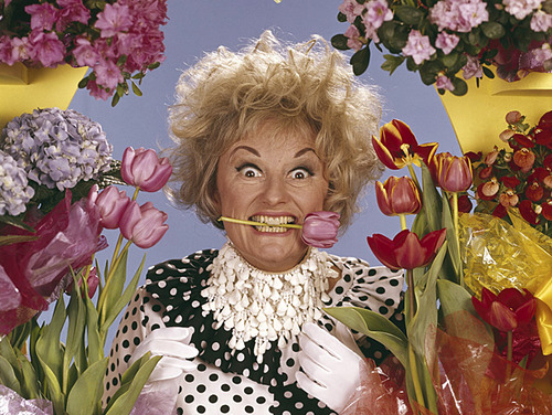 Phyllis Diller tiptoes through the tulips